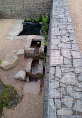 A water feature was created to manage a natural spring flowing through the area.