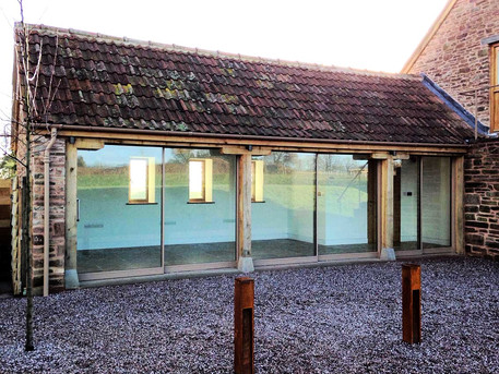 The single storey barn transformed into a stunning, well lit office due to the bespoke glazing that was fitted along one side.