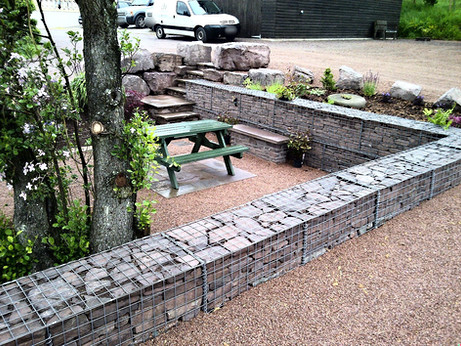 Here you can see the gabions separating the lower level garden from the higher parking area.