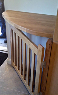 A bespoke oak gate was made to keep the client's dogs out of their brand new kitchen.