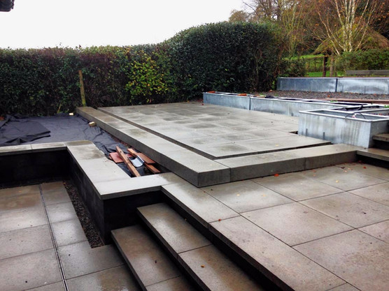 A structural patio garden was the outside focus of this new build.  Sheep troughs were positioned as planting beds and then concealed with stonework to create a seamless finish.