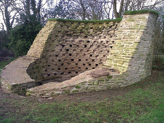 This historic dovecote at a Landmark Trust property in Shropshire was stabalised and consolidated, with the stonework raked out and re-pointed.