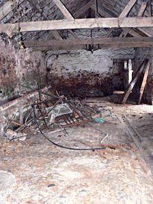The inside of the barn before any of the clearing out works started.