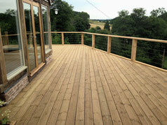 The finished decking with the surrounding wood and wire fencing.