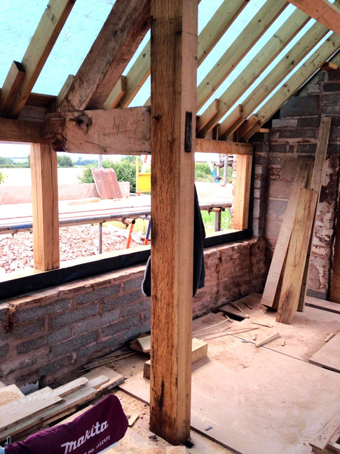 As much of the original barn was conserved as possible.  Here new timbers were added to the existing oak trusses.