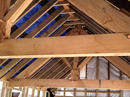 Oak trusses have been skillfully crafted for this new roof.
