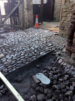 Cobbles being laid at Ludlow Castle.
