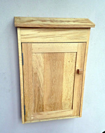 A bespoke oak cover made to disguise an electrical meter box.