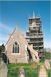 Scaffolding surrounds the spire during its construction.