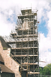 Progress photo of a church spire being constructed.