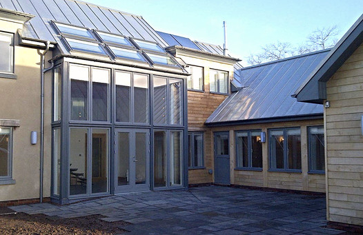 A stainless steel roof completes the look of this new, eco build