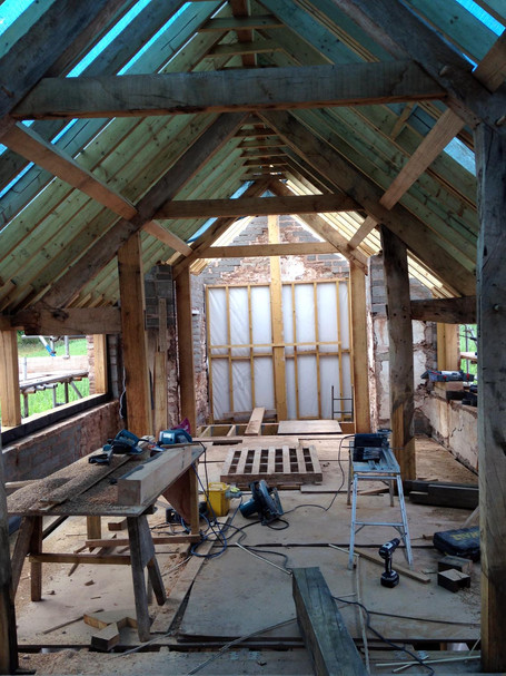 Our carpenters repaired the original roof trusses where possible, and then added new timbers to create a solid structure.