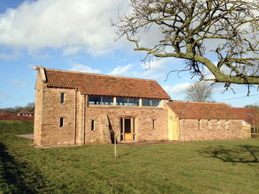 This barn conversion used salvaged stone merged with the old existing stone to ensure a seamless finish in keeping with the barn's appearance.