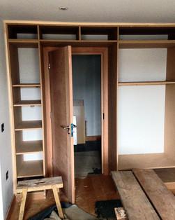 Bespoke bedroom storage in progress.