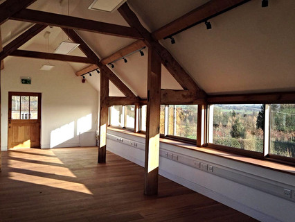 Glazed panels create a stunning outlook of the surrounding countryside and illuminate the upper floor.
