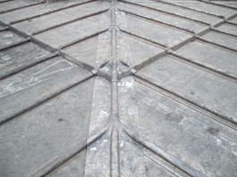 Detail of leadwork on a manor house roof.