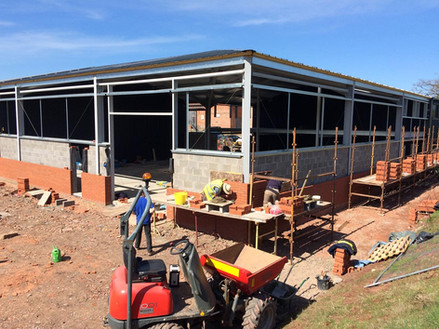 Block and brickwork surround the metal frame of this new build.