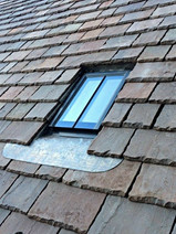 New stone slates and conservation style rooflight.