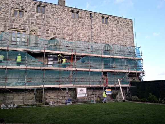 This elevation at Chirk Castle required the defective mortar joints to be raked out and repointed.