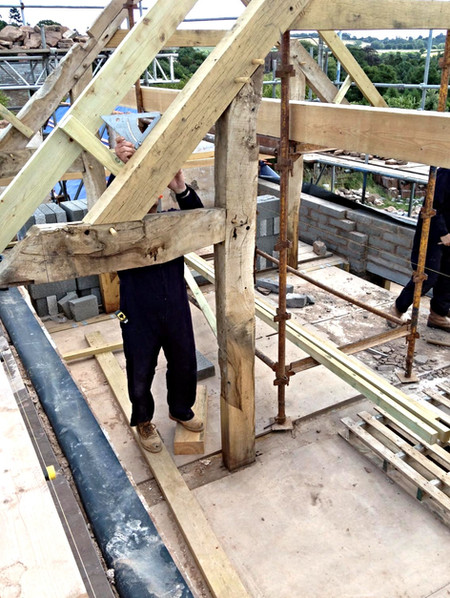 New oak has been introduced to repair a timber structure.
