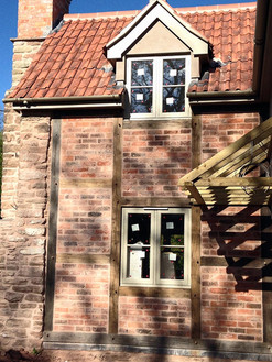 This renovated cottage had the plaster panels replaced with brickwork.