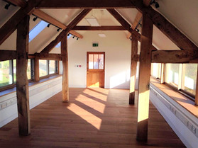 The structure of this barn conversion required sections of the existing oak beams to be seamlessly tied in with new oak using traditional jointing techniques.  The windows and wooden floor boards were also fitted to complete the look of the first floor.
