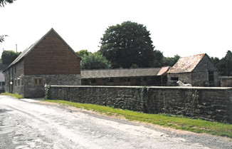 The stables and barn complex, with the renovated barn on the left.