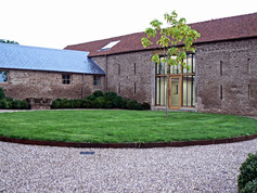 A landscaped drive finished one of the entrances into the barn complex.