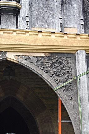 The new carvings are fitted and fixed in place.