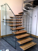 A bespoke staircase creates a bold statement in the hallway of this new build.
