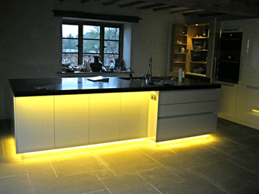 Cabinet and worktop lighting create a striking effect in this kitchen.