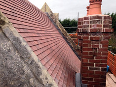 Clay tiles bring a new lease of life to this stone and brick building, whilst still blending in with it's historic surroundings.
