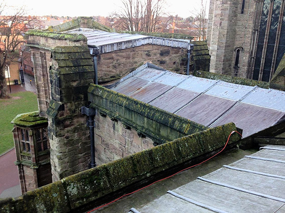This section of roof on Hereford Cathedral was no longer watertight and needed replacing.  The stone parapet also needed rebedding with replacement sections as necessary.