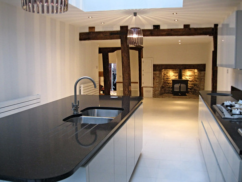 Kitchen and feature fireplace lighting.