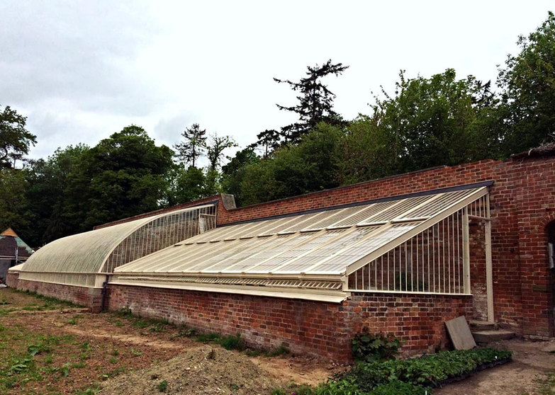 The restored glasshouse nearing completion.