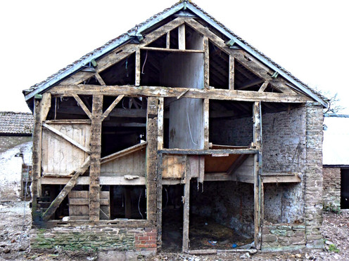 The end of one of the barns early in the project.