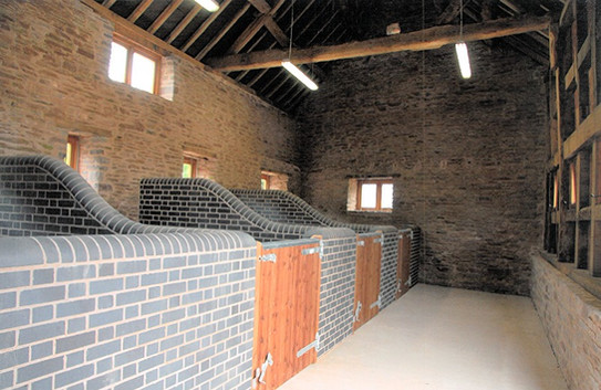 Blue brick stable stalls were added to the inside of one of the barns.