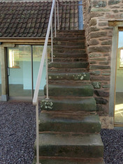 Granary steps were restored to their former glory at this barn conversion