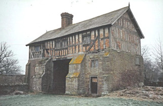 The gatehouse before improvement works began, which clearly shows the poor condition of the timber frame structure at first floor level.