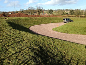 Tonnes of soil were sculpted into a sweeping curve for this stunning driveway and parking area.