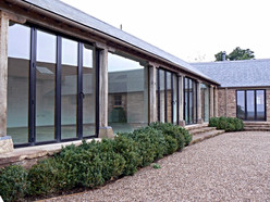 Large double glazed panels replace where empty voids once were, providing outstanding views of the surrounding countryside.
