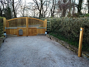 Electric wooden gates were made and fitted to the entrance of this driveway.