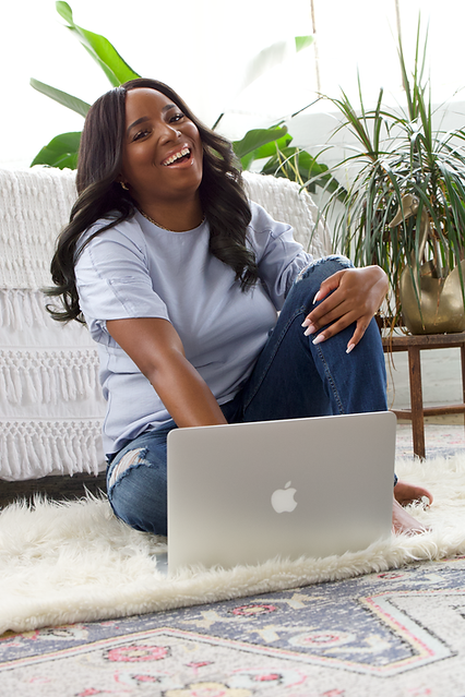 karima williams on floor with apple macbook air