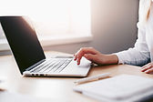 business-woman-working-on-laptop-in-her-