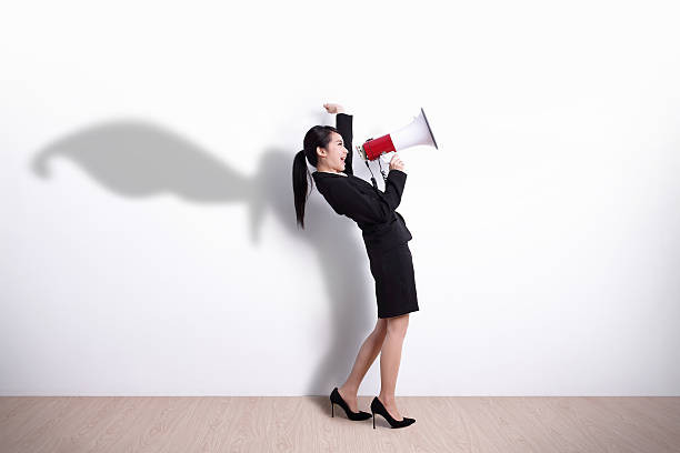 woman yells into a megaphone against a white background