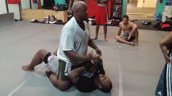 Coach CJ Bell instructing MMA class