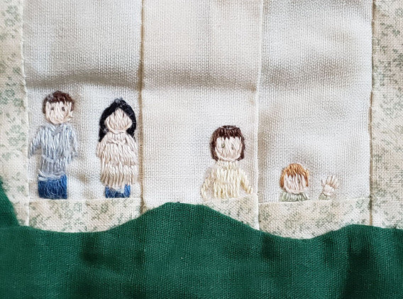 Jean embroidered her four children in the design.