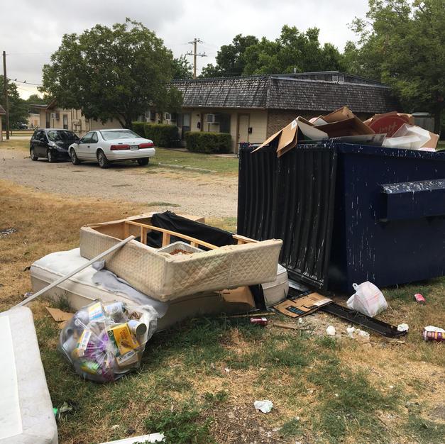Beside a dumpster