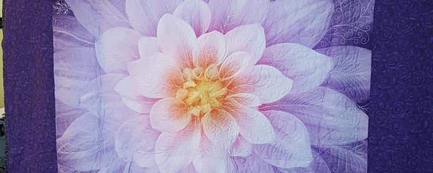 Lavender flower on Purple Quilt
