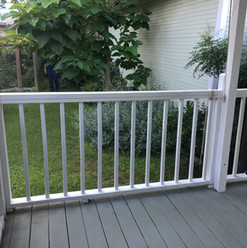 The newly painted white rails